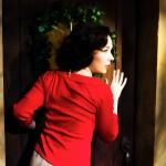 Dorothea (Maggie Mason) eavesdrops on her husband.