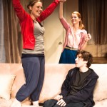 Grace (Rebecca Schweitzer*) finally gets up from the sofa! (Melissa Quine and Jeremy Kahn observe).
