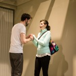Joe (Kyle Cameron) pleads with Kelly (Liz Sklar) to stay.