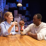Didi Marcantel (Susi Damilano*) and Leo Price (Carl Lumbly*) bond over a beer.