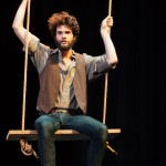Con (Adam Magill) contemplates life on the swing.