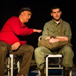 Pete (Michael Gene Sullivan*) and Eddie Birdlace (Jeffrey Brian Adams*) meet on a Trailways bus.