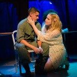 Eddie Birdlace (Jeffrey Brian Adams*) is consoled by Rose Fenny (Caitlin Brooke).