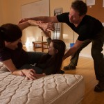 Kate (Sally Dana), The Girl (Rachel Goldberg), and Stine (Michael Storm) struggle.