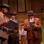 Steven Kodaly (Rodney Earl Jackson Jr.*), Georg Nowack (Jeffrey Brian Adams*) and Ladislav Sipos (Joseph Estlack*) read the newspaper.