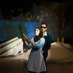Hadia (Livia Demarchi) is taken into garden by Uday Hussein (Pomme Koch).