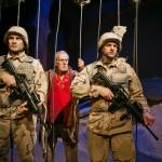 Marines (Craig Marker* L, Gabriel Marin* R) guard Tiger (Will Marchetti*) in the Baghdad Zoo.