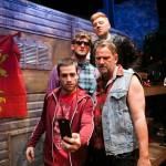 Watching video proof of wild party: Lee (Paris Hunter Paul*), Johnny (Brian Dykstra*), Davey (Joshua Schell), Ginger (Ian Scott McGregor*).