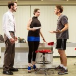 Joe (Kyle Cameron) and his assistant Kelly (Liz Sklar) receive directives from their boss (Patrick Russell) for a new TV project.