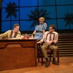Buddy (Ryan Drummond*) gives script feedback to Stine (Jeffrey Brian Adams*) with Donna (Monique Hafen*) looking on.