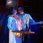 Fector (Nikita Burshteyn) carouses with his date (Sally Dana*) at the party.