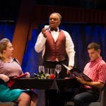 A waiter scoffs at his tip as Rose (Caitlin Brooke) and Eddie (Jeffrey Brian Adams*) sit at a restaurant.