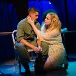 Eddie Birdlace (Jeffrey Brian Adams*) is consoled by Rose Fenny (Caitlin Brooke).