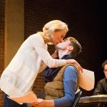 She (Carrie Paff*) kisses understudy Kevin (Allen Darby) as Director (Mark Anderson Phillips*) looks on during auditions.