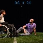 Mike (Jason Stojanovski) talks with his physical therapist, Jerry (Wiley Naman Strasser).
