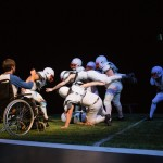 Mike, in a wheelchair (Jason Stojanovski), re-watches the play that changed his life.