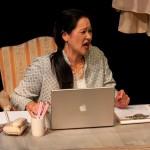 Julia (Karen Offereins) at her office.