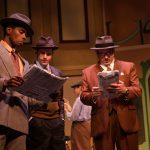 Steven Kodaly (Rodney Earl Jackson Jr.*), Georg Nowack (Jeffrey Brian Adams*) and Ladislav Sipos (Joseph Estlack*) read the newspaper.
