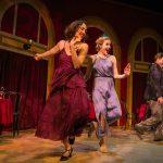 Dancers (L-R: Ayelet Firstenberg, Leah Shesky, Jason Rehklau) dance in the restaurant.