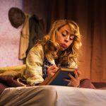 """Amalia Balash (Monique Hafen*) pens a letter to her """"Dear Friend."""""""